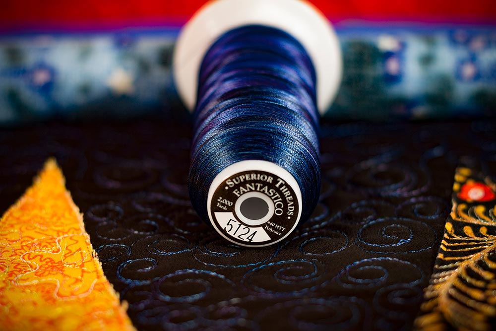 Indigo Fantastico thread for the background quilting