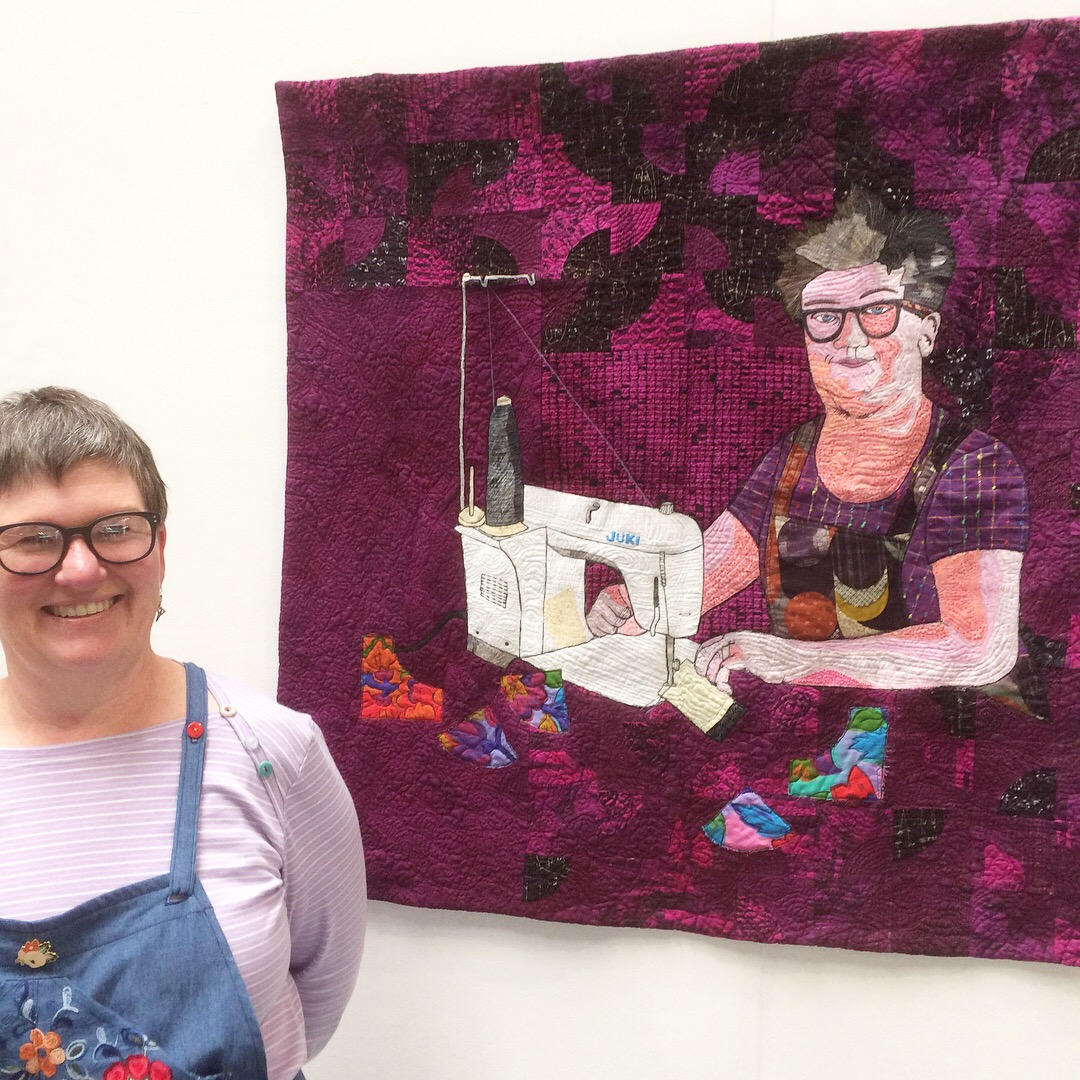 Rhonda Hazell with her portrait quilt at the FOQ 2018