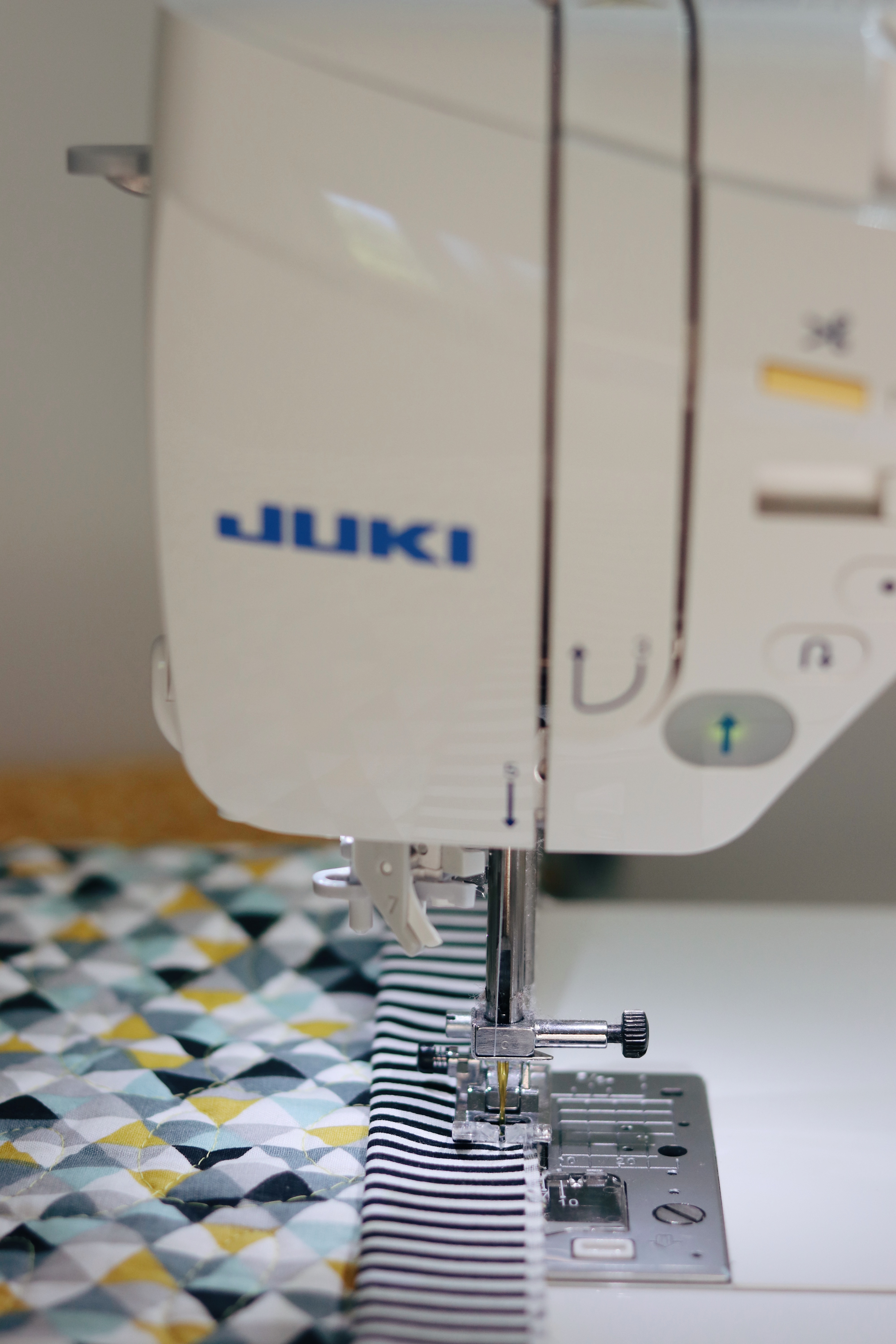 Machine stitching the binding with the Juki DX7