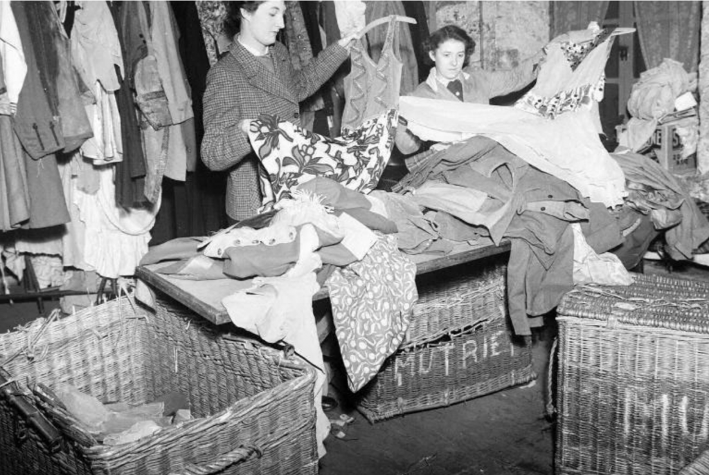 Mutrie and Sons costumiers Edinburgh historic photo - women sort through sewn textile costumes