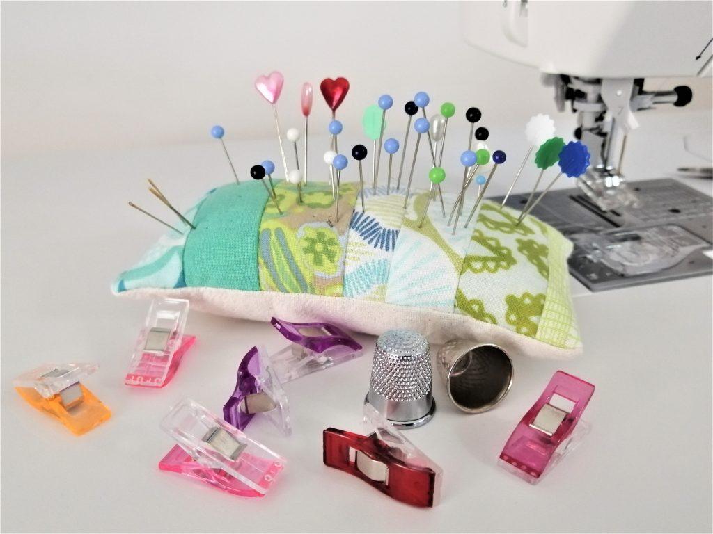 pins, sewing clips and thimbles