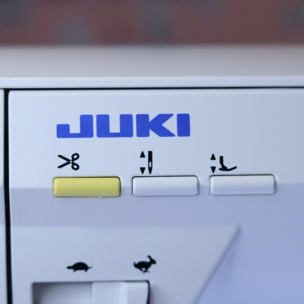 The thread trimmer button on the Juki NX7 sewing machine