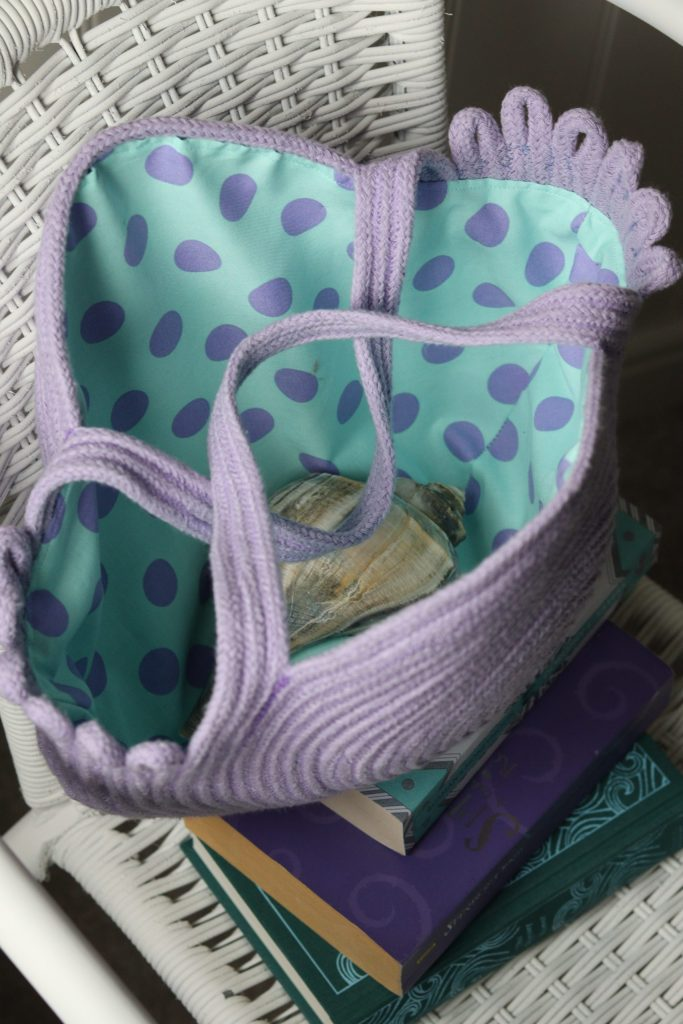 lined rope bag on books